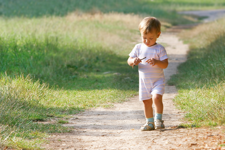 Baby Boy Walking In Park